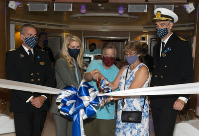 From left to right: Hotel General Manager Riccardo Capraro, Princess Cruises President Jan Swartz, First Guests Blake and Lara Handler and Captain Andrea Spinardi celebrate Grand Princess return with ribbon cutting.