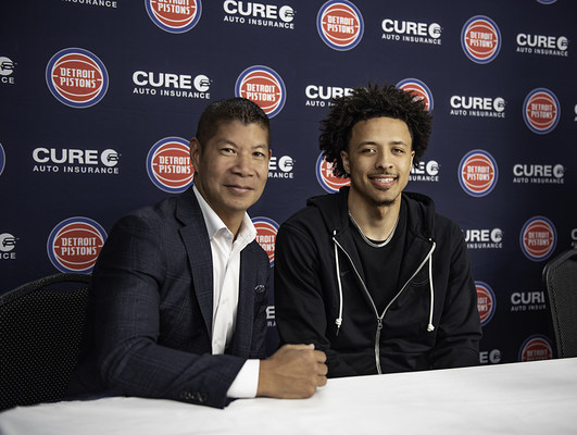 Eric S. Poe, CEO, CURE auto insurance and Cade Cunningham, Detroit Pistons 2021 #1 overall draft pick (PRNewsfoto/CURE Auto Insurance)